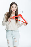Woman holding hanger Stock Photo