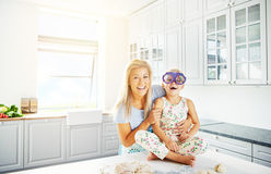 Woman holding happy child in silly glasses Stock Photos