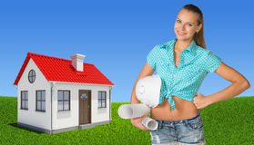 Woman holding hard hat and drawing rolls Royalty Free Stock Photo