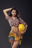 Woman holding hardhat Stock Photo