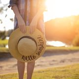 Woman holding hat Stock Photo
