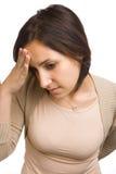Woman holding head Stock Photo