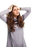 Woman holding head with hands. Royalty Free Stock Image