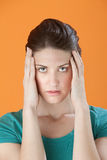 Woman Holding Head in Pain Royalty Free Stock Photography