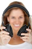 Woman holding headphones Royalty Free Stock Image