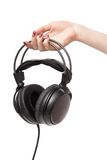 Woman holding headphones Royalty Free Stock Images