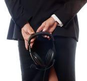 Woman holding headphones Stock Photography
