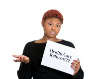 Woman holding health care reform sign Royalty Free Stock Photography