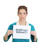 Woman holding healthcare reform sign Royalty Free Stock Image