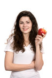 Woman Holding Healthy Apple. Smiling young woman holds an apple for a healthy lifestyle concept Stock Images