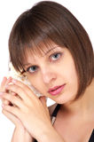 Woman holding and hearing a shell Stock Photos