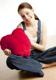 Woman holding a heart Royalty Free Stock Photography
