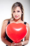 Woman holding a heart Royalty Free Stock Photos