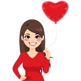 Woman Holding Heart Balloon Stock Photography