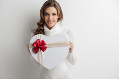 Woman holding heart gift Royalty Free Stock Images