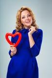 Woman holding heart Royalty Free Stock Photos