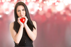 Woman Holding a Heart in Her Hands Royalty Free Stock Photos