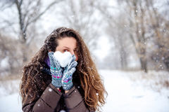 Woman holding heart made of snow Royalty Free Stock Photos