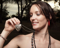 Woman holding a heart necklace Royalty Free Stock Images