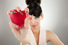 Woman holding heart in one hand stock photos