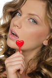 Woman holding heart in open mouth Royalty Free Stock Photos