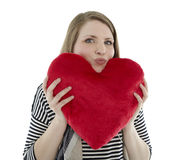 Woman holding heart pillow Stock Photo