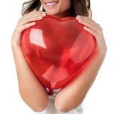 Woman holding heart royalty free stock photo
