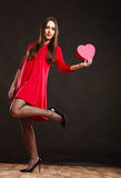 Woman holding heart in red dress. Royalty Free Stock Image