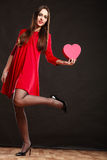 Woman holding heart in red dress. Stock Photography
