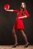 Woman holding heart in red dress. Royalty Free Stock Images