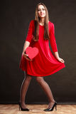 Woman holding heart in red dress. Royalty Free Stock Photo