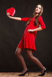 Woman holding heart in red dress. Stock Images