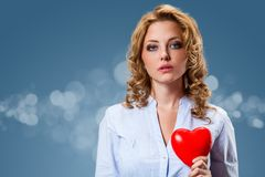 Woman holding heart shape Stock Photos