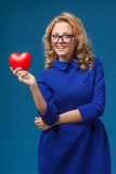 Woman holding heart shape Stock Images