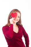 Woman holding heart shape to her face Royalty Free Stock Photography