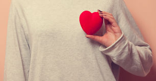 Woman holding heart shape toy Royalty Free Stock Photo