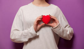 Woman holding heart shape toy Stock Images