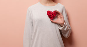 Woman holding heart shape toy Stock Image