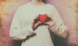 Woman holding heart shape toy Royalty Free Stock Photos