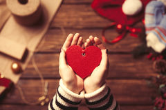 Woman holding a heart shape toy. In the hands before wrapping Royalty Free Stock Image