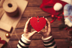 Woman holding a heart shape toy Stock Image