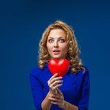 Woman holding heart shape Royalty Free Stock Image