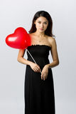 Woman holding a heart shaped balloon Stock Photography