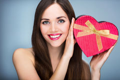 Woman holding heart-shaped box Stock Photography