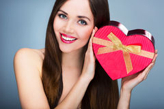 Woman holding heart-shaped box Royalty Free Stock Image