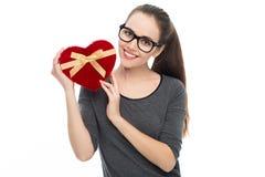 Woman holding heart-shaped box Royalty Free Stock Image