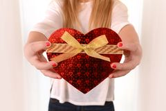 Woman holding Heart Shaped Box Present Stock Image