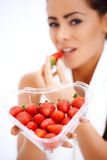 Woman holding heart shaped box of strawberries Stock Photos