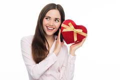 Woman holding heart-shaped box Stock Images