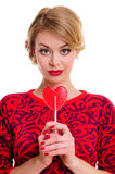 Woman holding heart-shaped candy Royalty Free Stock Photography